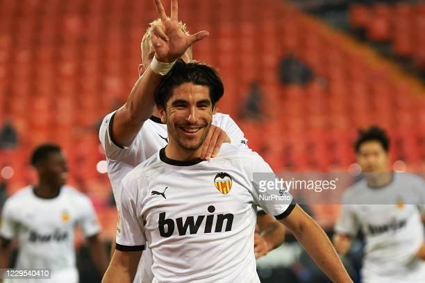 Carlos Soler of Valencia celebrates after scoring his sides third goal during the La Liga Santander match between Valencia CF and Real Madrid at...