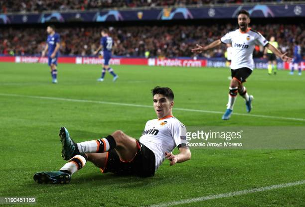 Carlos Soler of Valencia celebrates after scoring his team's first goal during the UEFA Champions League group H match between Valencia CF and...