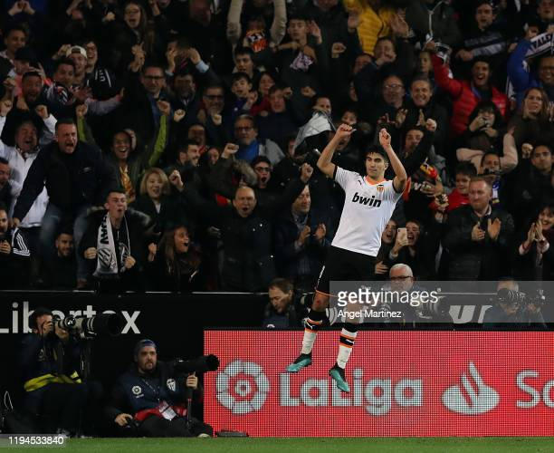 Carlos Soler of Valencia celebrates after scoring his team's first goal during the Liga match between Valencia CF and Real Madrid CF at Estadio...