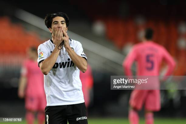Carlos Soler of Valencia celebrates after scoring his team's fourth goal during the La Liga Santander match between Valencia CF and Real Madrid at...