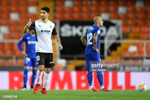 Carlos Soler of Valencia celebrates after scoring their side's first goal during the La Liga Santader match between Valencia CF and Getafe CF at...