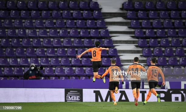 Carlos Soler of Valencia celebrates after scoring their team's first goal during the La Liga Santander match between Real Valladolid CF and Valencia...