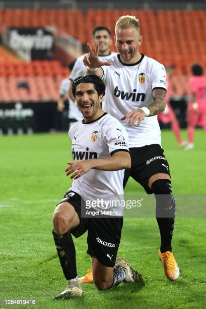 Carlos Soler of Valencia celebrates with teammate Uroc Racic after scoring his team's fourth goal during the La Liga Santander match between Valencia...
