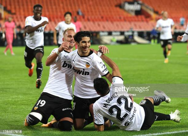 Carlos Soler of Valencia celebrates with teammates after scoring his team's third goal during the La Liga Santander match between Valencia CF and...
