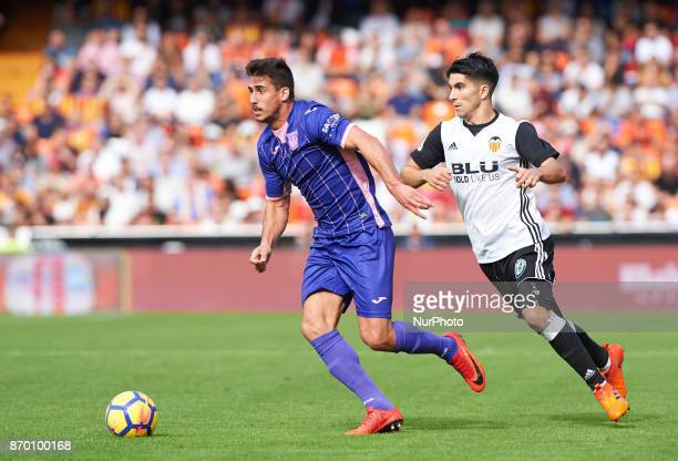 Carlos Soler of Valencia CF and Gabriel Pires of Club Deportivo Leganes in action during the La Liga match between Valencia CF and Club Deportivo...