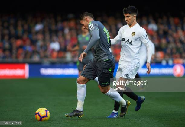 Carlos Soler of Valencia CF and Theo Hernandez of Real Sociedad during the La Liga match between Valencia and Real Sociedad at Estadio de Mestalla on...