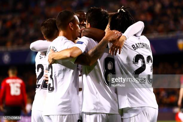 Carlos Soler of Valencia CF celebrate after scoring the 10 goal with his teammate during UEFA Champions League Group H between Valencia CF and...