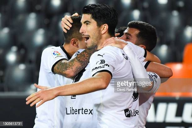 Carlos Soler of Valencia CF celebrates after Goncalo Guedes scored his team's second goal during the La Liga Santander match between Valencia CF and...