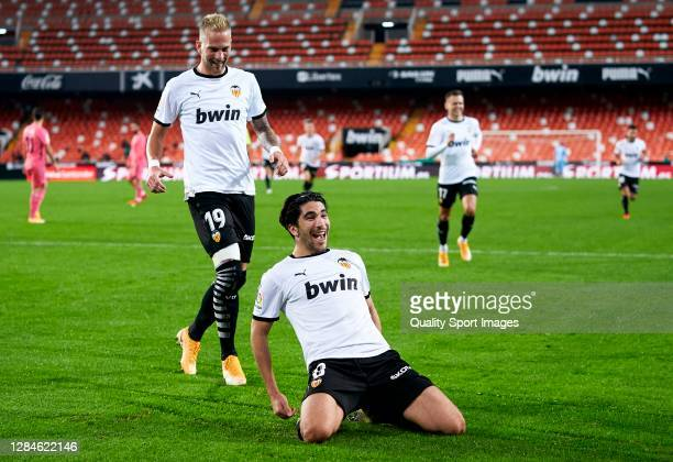 Carlos Soler of Valencia CF celebrates after scoring his team's fourth goal during the La Liga Santander match between Valencia CF and Real Madrid at...