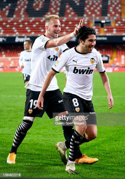 Carlos Soler of Valencia CF celebrates after scoring his team's fourth goal with his teammate Uros Racic during the La Liga Santander match between...