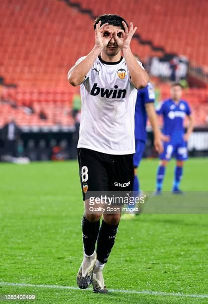 Carlos Soler of Valencia CF celebrates after scoring his team's second goal during the La Liga Santander match between Valencia CF and Getafe CF at...