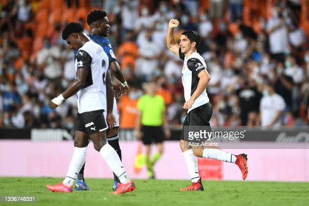 Carlos Soler of Valencia CF celebrates after scoring their side's second goal during the La Liga Santander match between Valencia CF and Deportivo...