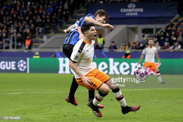 Carlos Soler of Valencia CF competes for the ball with Marten De Roon of Atalanta during the UEFA Champions League round of 16 first leg match...