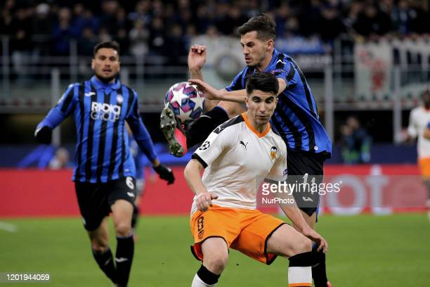 Carlos Soler of Valencia CF competes for the ball with Remo Freuler of Atalanta during the UEFA Champions League round of 16 first leg match between...