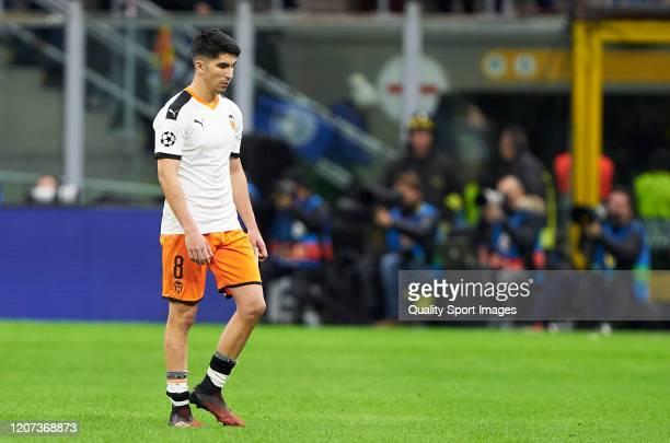 Carlos Soler of Valencia CF leaves the picth after the UEFA Champions League round of 16 first leg match between Atalanta and Valencia CF at San Siro...