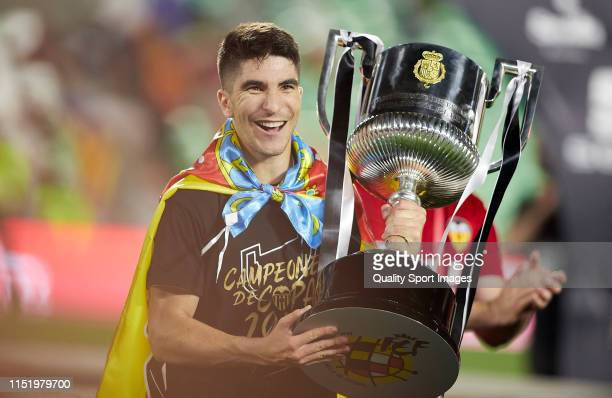 Carlos Soler of Valencia CF lifts the trophy after the Spanish Copa del Rey Final match between Barcelona and Valencia at Estadio Benito Villamarin...