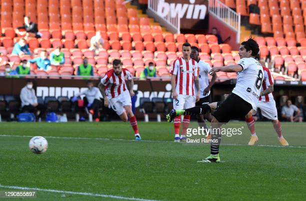 Carlos Soler of Valencia CF scores a penalty for his team's first goal during the La Liga Santander match between Valencia CF and Athletic Club at...