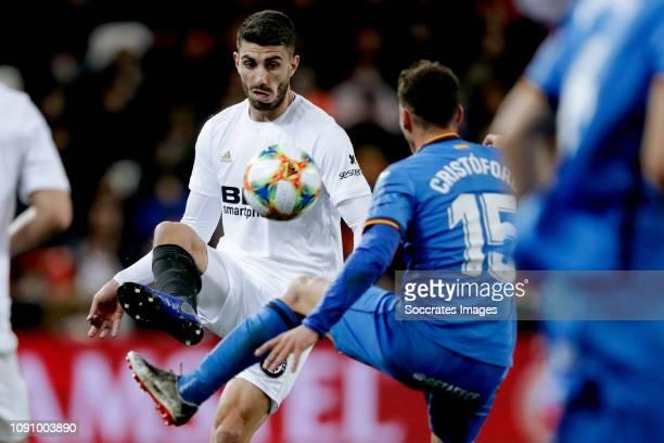 Carlos Soler of Valencia CF Sebastian Cristoforo of Getafe CF during the Spanish Copa del Rey match between Valencia v Getafe at the Estadio de...