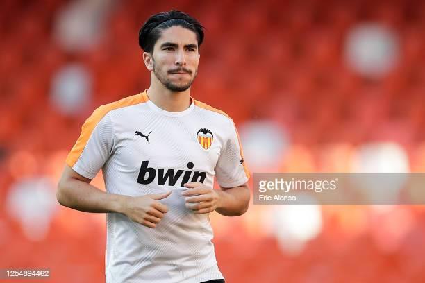 Carlos Soler of Valencia CF warms up during the Liga match between Valencia CF and Real Valladolid CF at Estadio Mestalla on July 07, 2020 in...