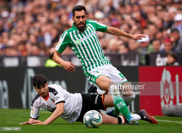 Carlos Soler of Valencia competes for the ball with Borja Iglesias of Real Betis during the Liga match between Valencia CF and Real Betis Balompie at...