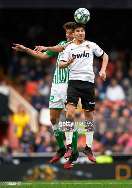 Carlos Soler of Valencia competes for the ball with Edgar Gonzalez of Real Betis during the Liga match between Valencia CF and Real Betis Balompie at...