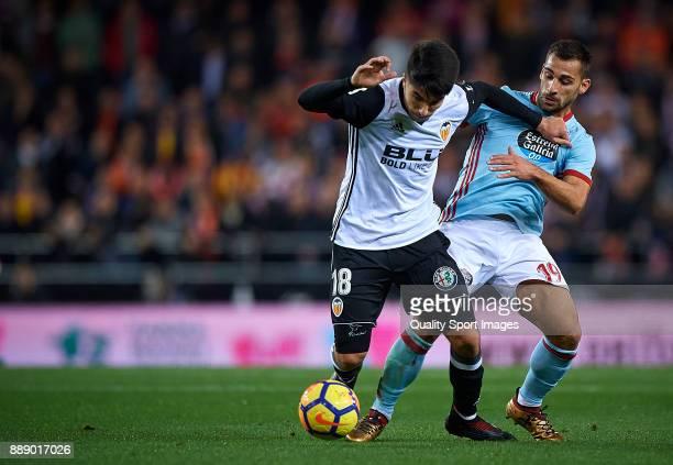 Carlos Soler of Valencia competes for the ball with Hugo Mallo of Celta de Vigo during the La Liga match between Valencia and Celta de Vigo at...