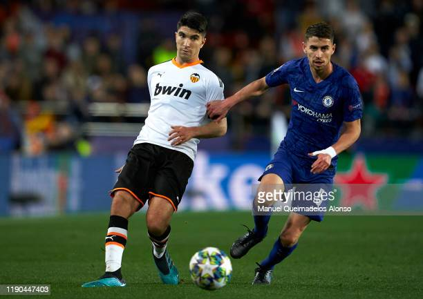Carlos Soler of Valencia competes for the ball with Jorginho of Chelsea during the UEFA Champions League group H match between Valencia CF and...