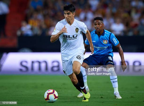 Carlos Soler of Valencia competes fot the ball with Wendell of Bayer Leverkusen during the preseason friendly match between Valencia CF and Bayer...
