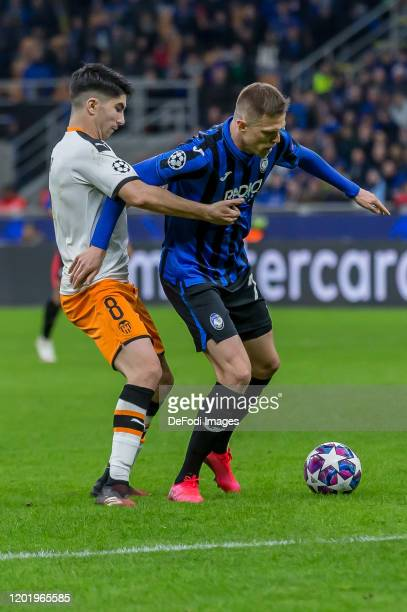 Carlos Soler of Valencia FC and Josip Ilicic of Atalanta Bergamo battle for the ball during the UEFA Champions League round of 16 first leg match...