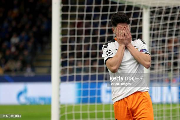 Carlos Soler of Valencia FC looks dejected during the UEFA Champions League round of 16 first leg match between Atalanta and Valencia CF at San Siro...