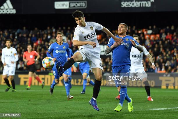 Carlos Soler of Valencia holds off Vitorino Antunes of Getafe during the Copa del Rey Quarter Final match between Valencia and Getafe at Estadio...