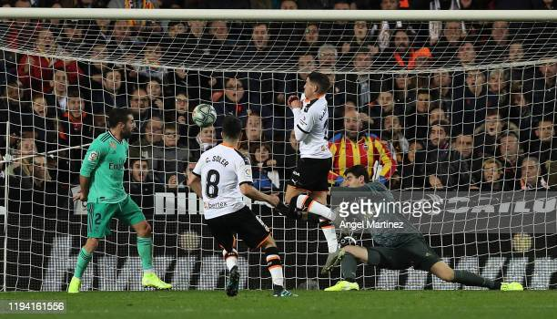 Carlos Soler of Valencia scores his team's first goal during the Liga match between Valencia CF and Real Madrid CF at Estadio Mestalla on December 15...