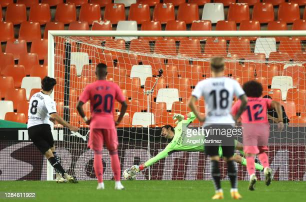 Carlos Soler of Valencia scores his team's first goal from the penalty spot during the La Liga Santander match between Valencia CF and Real Madrid at...