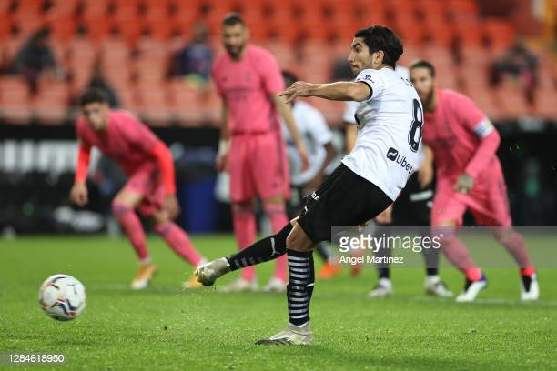 Carlos Soler of Valencia scores his team's fourth goal from the penalty spot during the La Liga Santander match between Valencia CF and Real Madrid...
