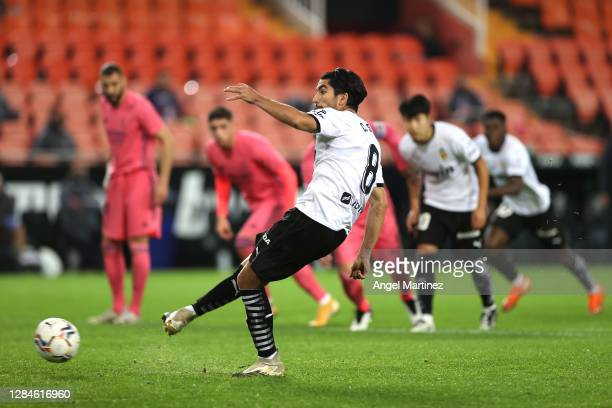 Carlos Soler of Valencia scores his team's third goal from the penalty spot during the La Liga Santander match between Valencia CF and Real Madrid at...