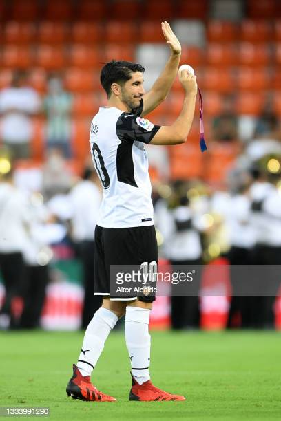 Carlos Soler of Valencia shows his silver medal from the 2021 Tokyo Olympic Games prior to the La Liga Santader match between Valencia CF and Getafe...