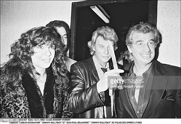 Carlos Sottomayor Johnny Hallyday and JeanPaul Belmondo in Johnny's dressing room the night of his concert in Palais Des Sports Paris