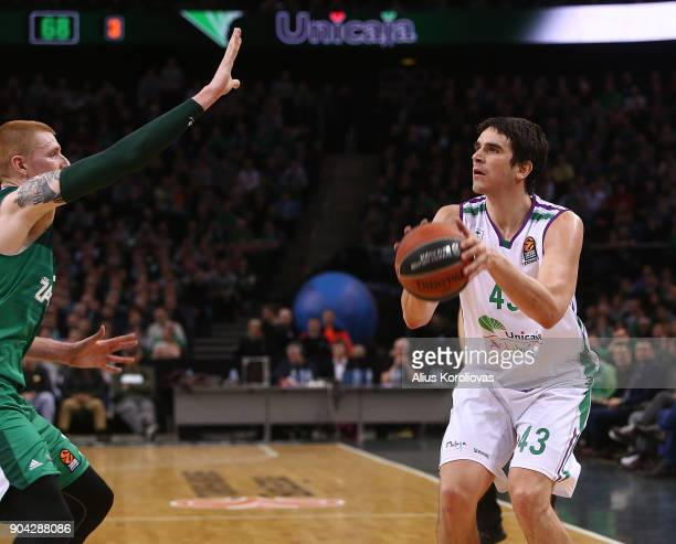 Carlos Suarez #43 of Unicaja Malaga competes with Aaron White #30 of Zalgiris Kaunas in action during the 2017/2018 Turkish Airlines EuroLeague...