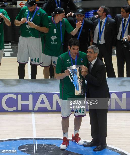 Carlos Suarez #43 of Unicaja Malaga gets the championship trophey from Jordi Bertomeu after winning the 20162017 7Days Eurocup Finals Leg 3 Valencia...