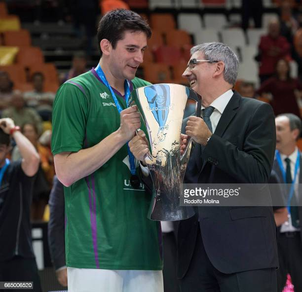 Carlos Suarez #43 of Unicaja Malaga receives the Champion Trophy from Jordi Bertomeu CEO Euroleague Basketball at the end of the 20162017 7Days...