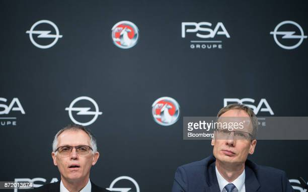 Carlos Tavares chief executive officer of PSA Group left speaks as Michael Lohscheller chief executive officer of Adam Opel AG looks on during a news...