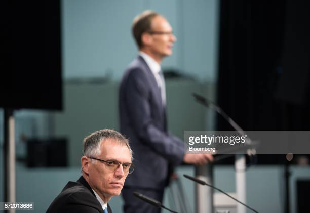 Carlos Tavares chief executive officer of PSA Group looks on as Michael Lohscheller chief executive officer of Adam Opel AG speaks during a news...