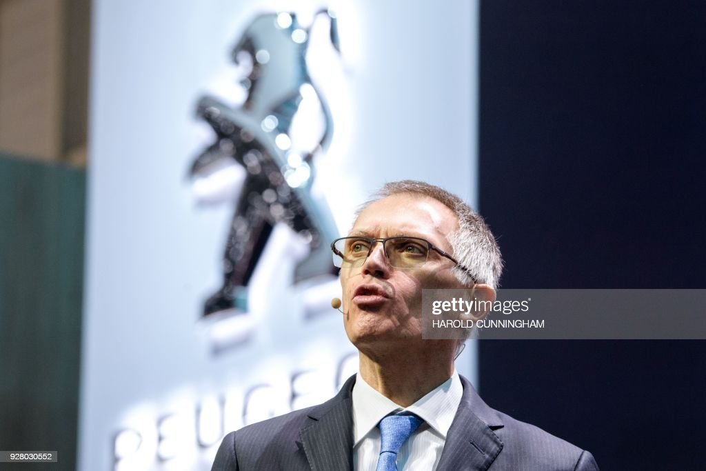 Carlos Tavares, PSA CEO, speaks at the French car maker's booth during a press day ahead of the Geneva International Motor Show on March 6, 2018 in Geneva. The show opens to the public on March 8 and runs through March 18. /