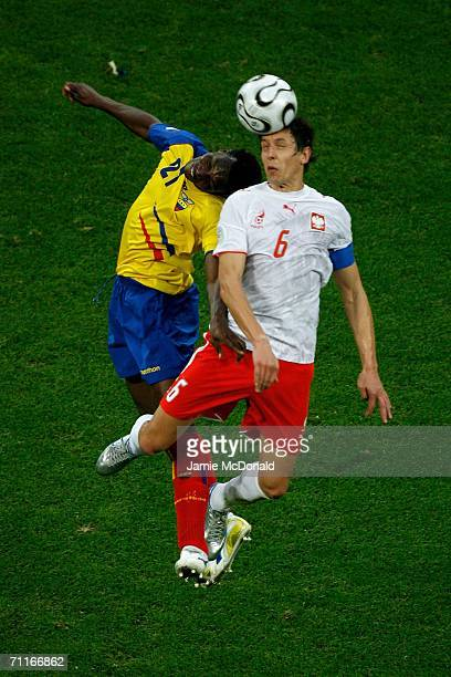Carlos Tenorio of Ecuador and Jacek Bak of Poland challenge for the header during the FIFA World Cup Germany 2006 Group A match between Poland v...