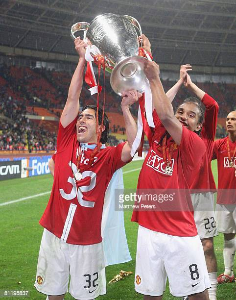 Carlos Tevez and Anderson of Manchester United celebrates with the trophy after winning the UEFA Champions League Final match between Manchester...