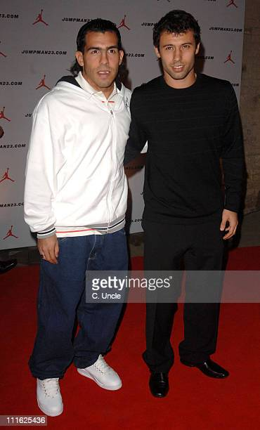 Carlos Tevez and Javier Mascherano during A Special Dinner to Celebrate Michael Jordan's Visit to the United Kingdom at The Roundhouse in London...