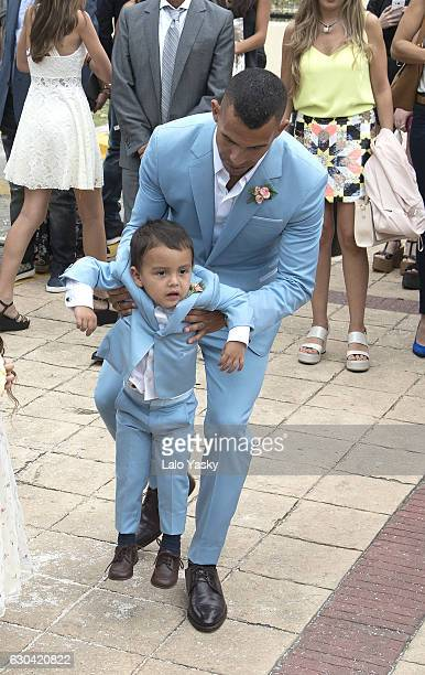 Carlos Tevez and Lito Junior Tevez leave the San Isidro City Hall after the civil wedding ceremony of Carlos Tevez and Vanesa Mansilla on December 22...