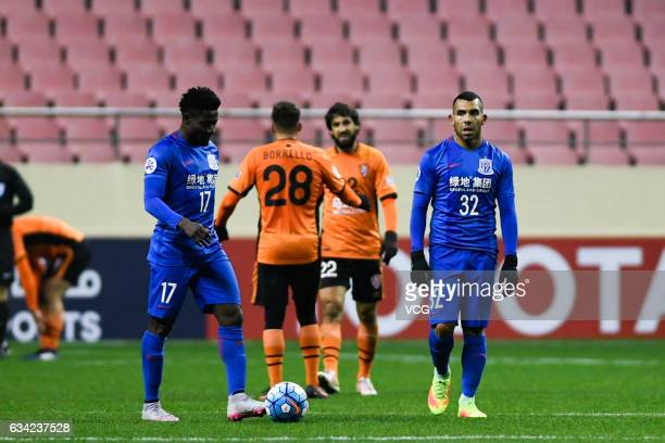 Carlos Tevez and Obafemi Martins of Shanghai Shenhua reacts after losing the second goal during the AFC Champions League 2017 playoff match between...