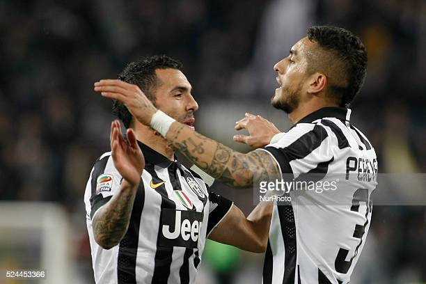 Carlos Tevez and Roberto Pereyra after the second goal of Juventus team during the Serie A match between Juventus FC and Empoli FC at Juventus...