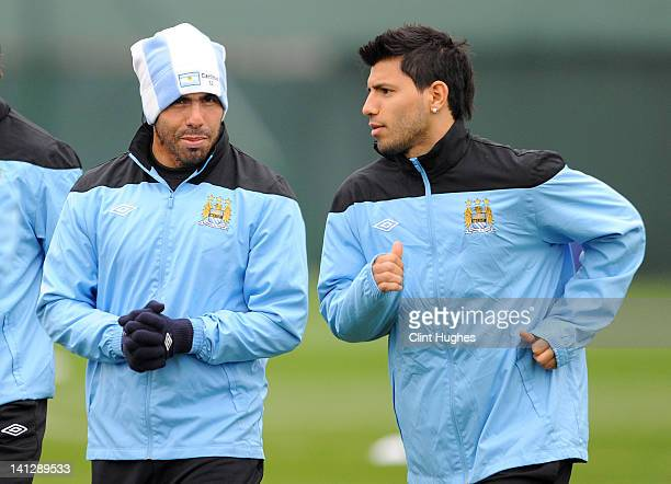 Carlos Tevez and Sergio Aguero of Manchester City attend a training session ahead of their UEFA Europa League Round 16 second Leg match against...